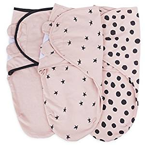 Pink swaddle blankets, one with just pink, one with black stars, one with black polka-dots